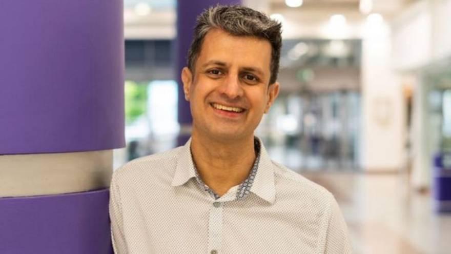Naveed Saghir smiling before being scammed